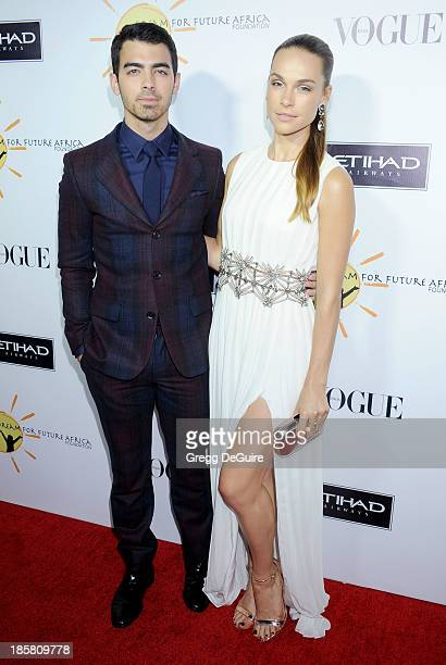 Musician Joe Jonas and model Blanda Eggenschwiler arrive at the Dream For Future Africa Foundation Gala at Spago on October 24, 2013 in Beverly...