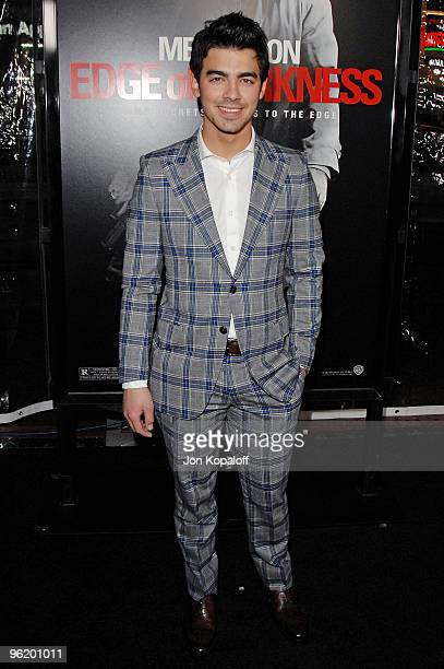 """Musician Joe Jonas arrives at the Los Angeles Premiere """"Edge Of Darkness"""" at Grauman's Chinese Theatre on January 26, 2010 in Hollywood, California."""