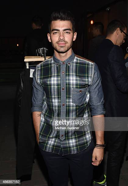 Musician Joe Jonas attends a GQ and Gap celebration of 2014's best new menswear designers in America at Ace Hotel on September 29 2014 in Los Angeles...
