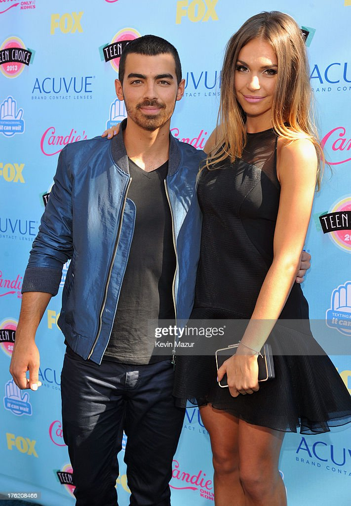 Musician Joe Jonas (L) attends the 2013 Teen Choice Awards at Gibson Amphitheatre on August 11, 2013 in Universal City, California.