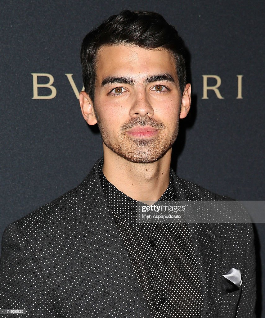 Musician Joe Jonas attends the BVLGARI 'Decades of Glamour' Oscar Party at Soho House on February 25, 2014 in West Hollywood, California.