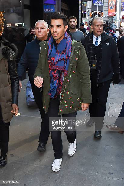 Musician Joe Jonas of DNCE leaves the 'Good Morning America' taping at the ABC Times Square Studios on November 23 2016 in New York City