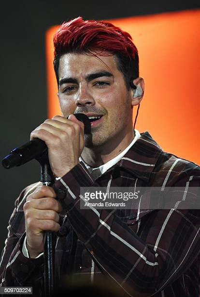 Musician Joe Jonas of the band DNCE performs onstage at the 1027 KIISFM Tinder Ball at the iHeartRadio Theater on February 11 2016 in Burbank...