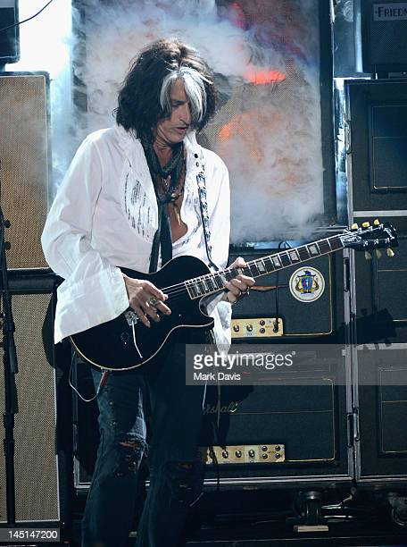 Musician Joe Perry of Aerosmith performs onstage during Fox's American Idol 2012 results show at Nokia Theatre LA Live on May 23 2012 in Los Angeles...