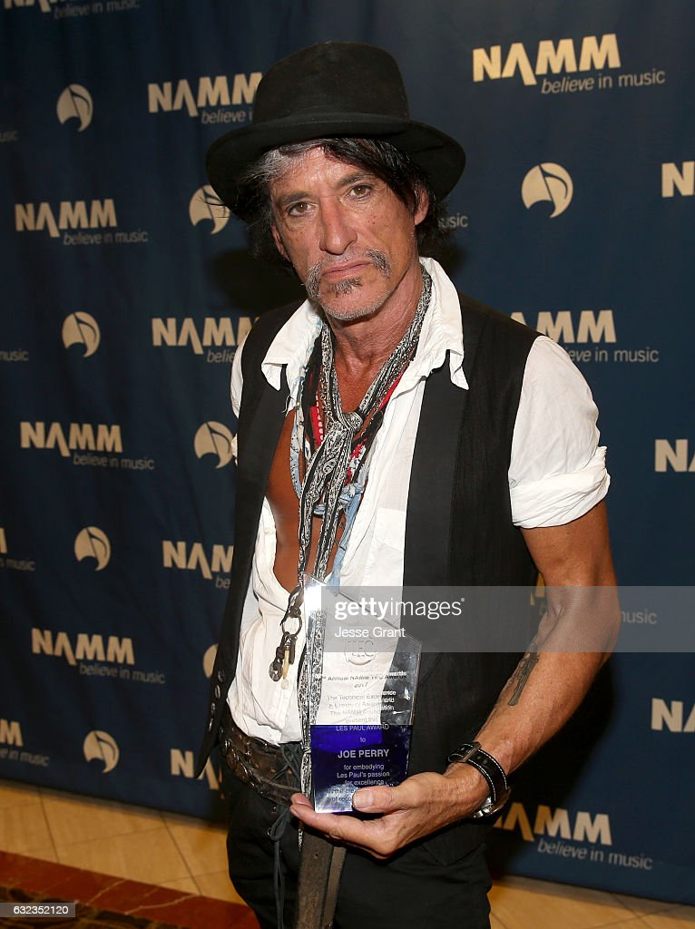 Musician Joe Perry poses backstage with the Les Paul Award at the TEC Awards during NAMM Show 2017 at the Anaheim Hilton on January 21, 2017 in Anaheim, California.