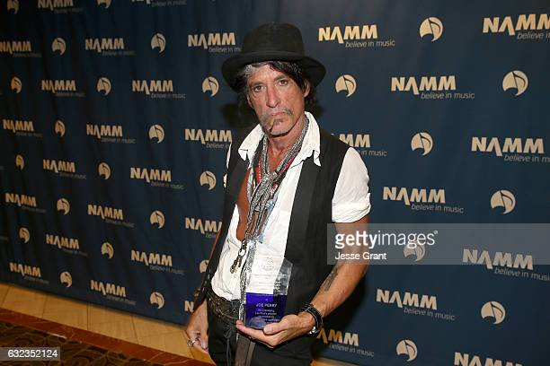 Musician Joe Perry poses backstage with the Les Paul Award at the TEC Awards during NAMM Show 2017 at the Anaheim Hilton on January 21 2017 in...