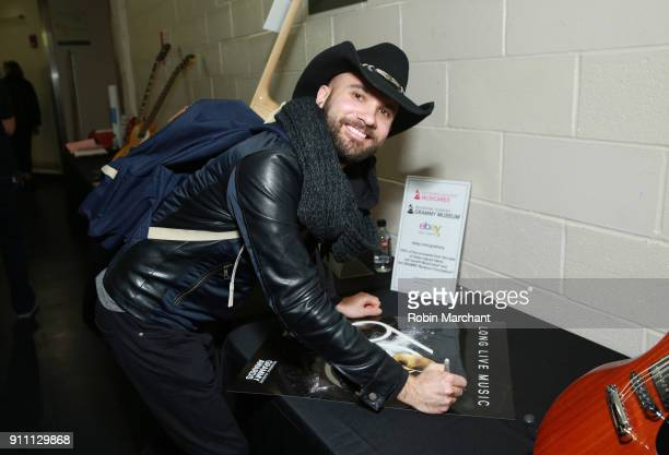 Musician Joe Saylor poses with the GRAMMY Charities Signings during the 60th Annual GRAMMY Awards at Madison Square Garden on January 27 2018 in New...