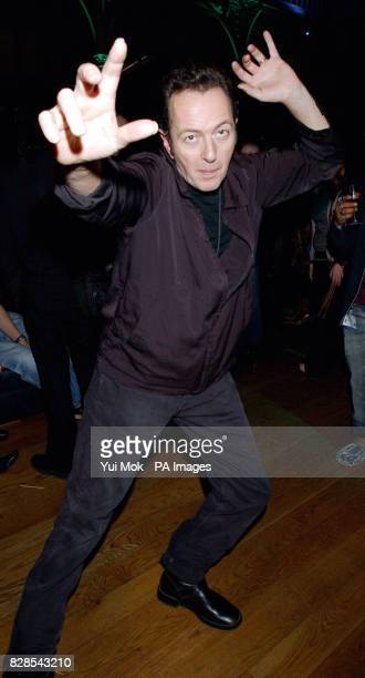 Musician Joe Strummer arriving for the The Dian Fossey Gorilla Fund rock concert at the Royal Opera House in London's Covent Garden to mark the 100th...