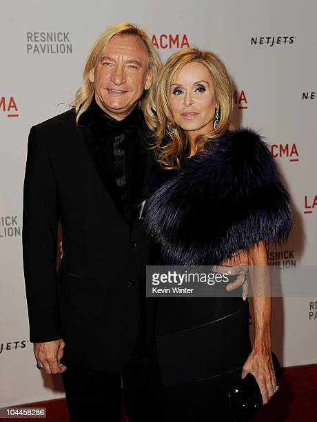 Musician Joe Walsh and his wife Marjorie Bach arrive at the opening Gala and Unmasking for the Resnick Pavilion at LACMA on September 25 2010 in Los...