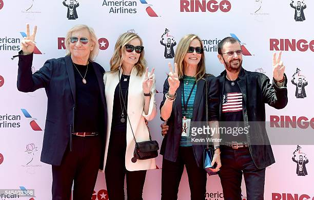 Musician Joe Walsh his wife Marjorie Bach her sister Barbara Bach and her husband musician Ringo Starr pose at Ringo Starr's Peace Love birthday...