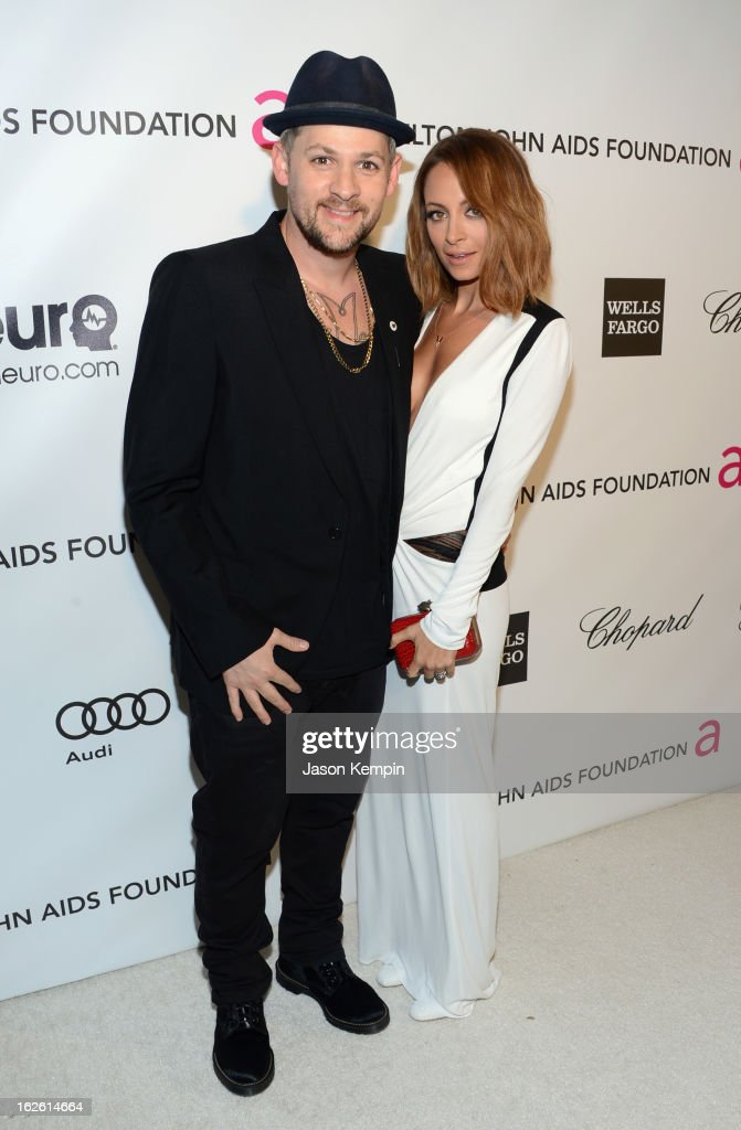 Musician Joel Madden (L) and TV personality Nicole Richie attend the 21st Annual Elton John AIDS Foundation Academy Awards Viewing Party at West Hollywood Park on February 24, 2013 in West Hollywood, California.