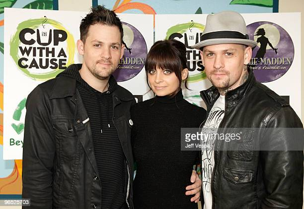 Musician Joel Madden Nicole Richie and musician Benji Madden attend the launch of '7Eleven's Coffee Cup with a Cause' and open a new playground at...