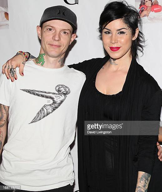 Musician Joel Zimmerman aka deadmaus and TV personality Kat Von D attend a  Niecy Nash signing