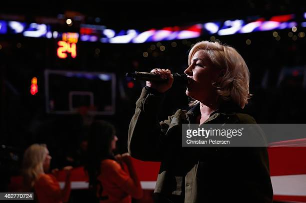 Musician Joelle James performs the national anthem before the NBA game between the Chicago Bulls and the Phoenix Suns at US Airways Center on January...