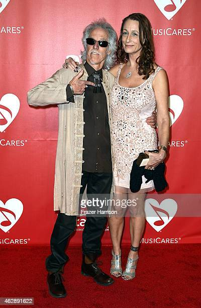Musician John Densmore and Ildiko Von Somogyi attend the 25th anniversary MusiCares 2015 Person Of The Year Gala honoring Bob Dylan at the Los...