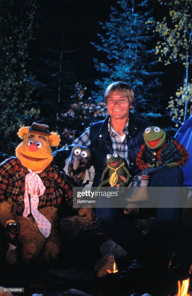 Musician John Denver poses with the Muppets during an episode of the ...