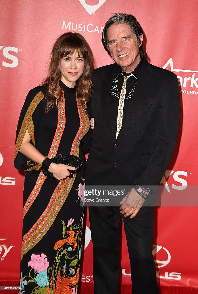 Musician John Doe (R) and guest attend the 25th anniversary MusiCares 2015 Person Of The Year Gala honoring Bob Dylan at the Los Angeles Convention Center on February 6, 2015 in Los Angeles, California. The annual benefit raises critical funds for MusiCares' Emergency Financial Assistance and Addiction Recovery programs. For more information visit musicares.org.