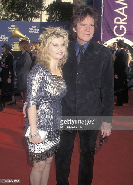 Musician John Fogerty and wife Julie Lebiedzinski attend the 41st Annual Grammy Awards on February 24 1999 at Shrine Auditorium in Los Angeles...