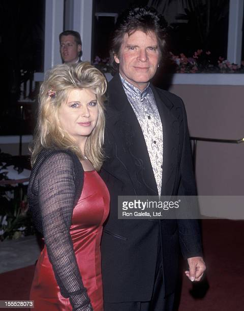 Musician John Fogerty and wife Julie Lebiedzinski attend the 41st Annual Grammy Awards PreParty hosted by Clive Davis and Arista Records on February...