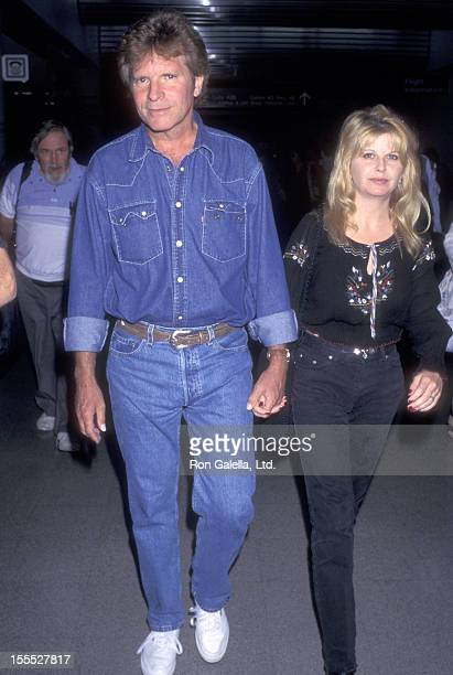 Musician John Fogerty and wife Julie Lebiedzinski on June 9 1997 arrive at the Los Angeles International Airport in Los Angeles California