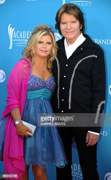 Musician John Fogerty arrives with his wife Julie Lebiedzinski for the 45th Academy of Country Music Awards in Las Vegas Nevada on April 18 2010 AFP...