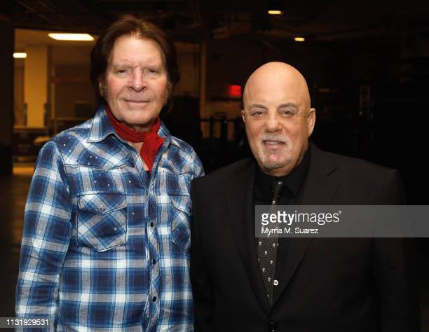 Musician John Fogerty backstage with Billy Joel at Joel's 62nd Sold Out Show at his residency at Madison Square Garden on March 21 2019 in New York...