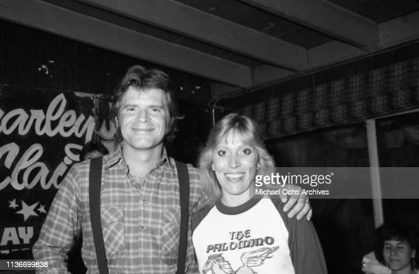 Musician John Fogerty poses for a portrait with a woman wearing a Palomino shirt at a Dick Dale Performace at the Palomino on January 4 1985 in Los...