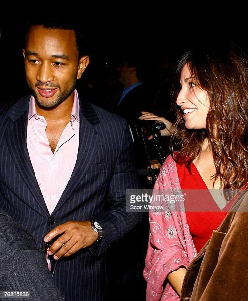 Musician John Legend and actress Gina Gershon attend 'Greeting Card' by artist Aaron Young at the Park Avenue Armory September 17 2007 in New York...