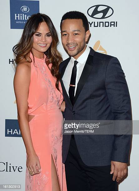 Musician John Legend and model Chrissy Teigen arrive at Clive Davis The Recording Academy's 2013 PreGRAMMY Gala and Salute to Industry Icons honoring...