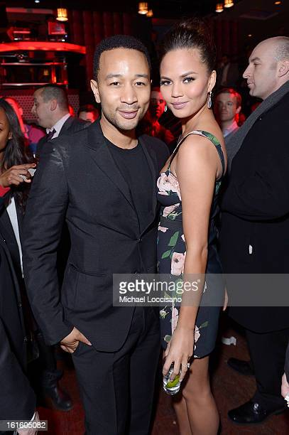 Musician John Legend and model Chrissy Teigen attend as Sports Illustrated celebrates SI Swimsuit 2013 with a starstudded kickoff event at Crimson on...