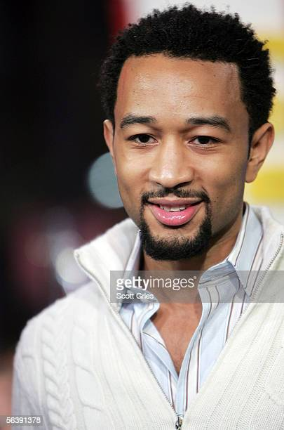 Musician John Legend appears onstage during 'Movie Week' on MTV's Total Request Live at the MTV Times Square Studios on December 8 2005 in New York...