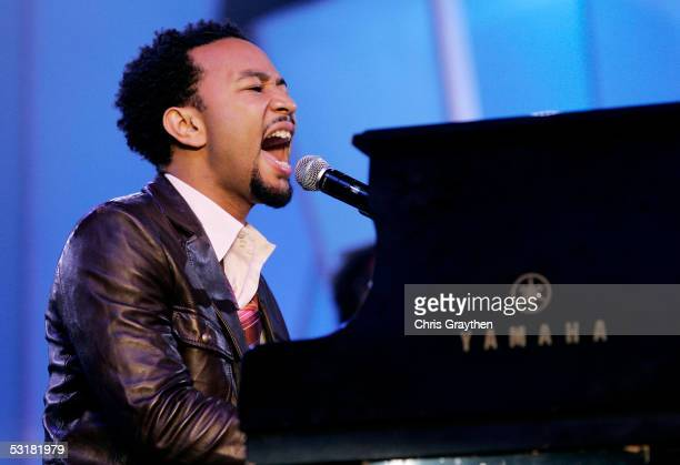 Musician John Legend performs at the 2005 Essence Festival at the New Orleans Superdome on July 1 2005 in New Orleans Louisiana