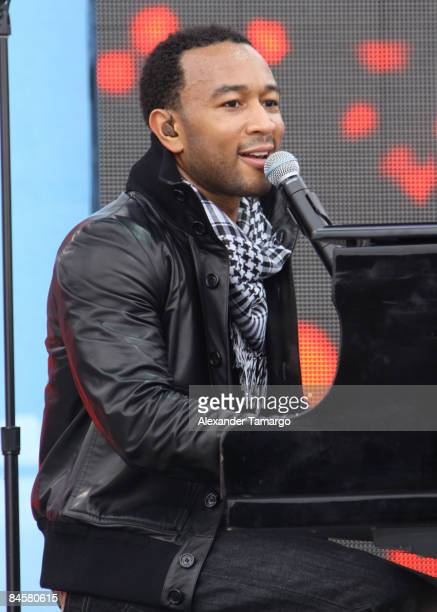 Musician John Legend performs during the pregame show before the pregame show prior to the start of Super Bowl XLIII between the Arizona Cardinals...