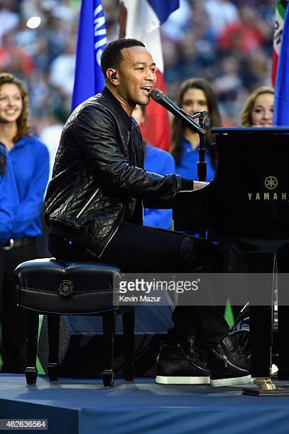Musician John Legend performs God Bless America during Super Bowl XLIX at University of Phoenix Stadium on February 1 2015 in Glendale Arizona