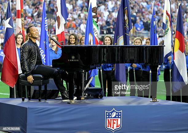 Musician John Legend performs 'God Bless America' during Super Bowl XLIX at University of Phoenix Stadium on February 1 2015 in Glendale Arizona