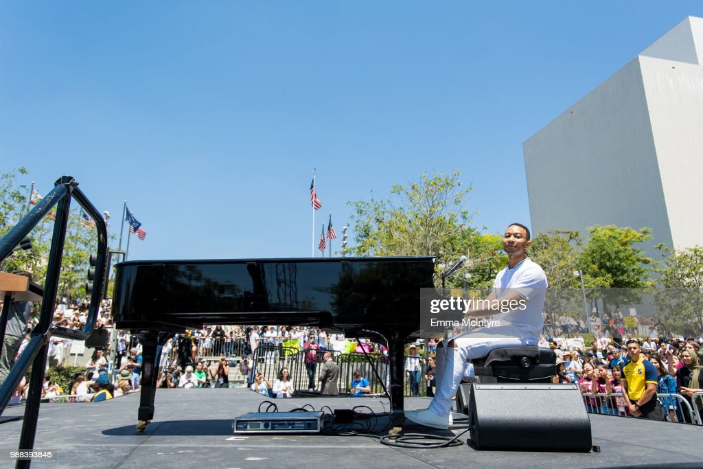 Musician John Legend performs onstage at 'Families Belong Together - Freedom for Immigrants March Los Angeles' at Los Angeles City Hall on June 30, 2018 in Los Angeles, California.