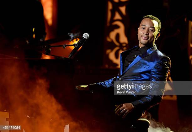 Musician John Legend performs onstage during the BET AWARDS '14 at Nokia Theatre LA LIVE on June 29 2014 in Los Angeles California