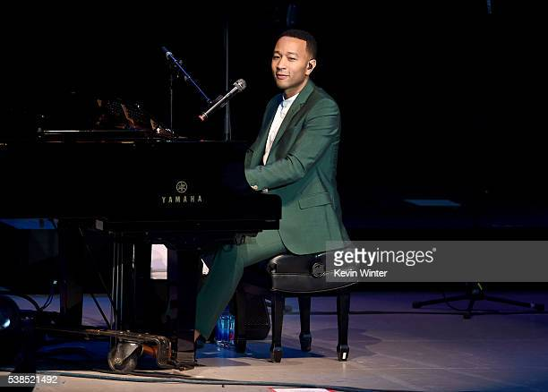 Musician John Legend performs onstage during the Hillary Clinton She's With Us concert at The Greek Theatre on June 6 2016 in Los Angeles California