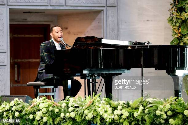 US musician John Legend plays the piano during the award ceremony of the 2017 Nobel Peace Prize at the city hall in Oslo Norway on December 10 2017...