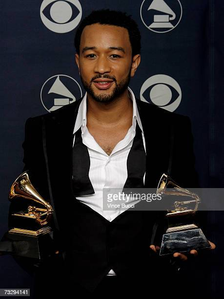 Musician John Legend poses with his Grammys for Best RB Performance By a Duo or Group with Vocals for 'Family Affair' and Best Male RB Vocal...