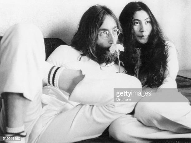 Musician John Lennon and wife Yoko Ono at a press conference from their bed in 1969 The couple announced that they would stay in bed seven days to...