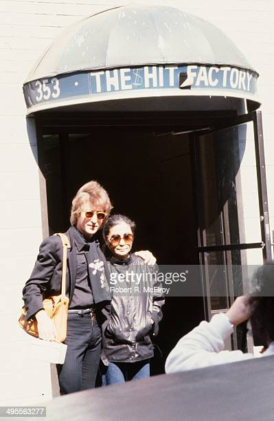 Musician John Lennon and wife Yoko Ono pose for a photo outside the Hit factory recording studio on September 18 1980 in New York City New York
