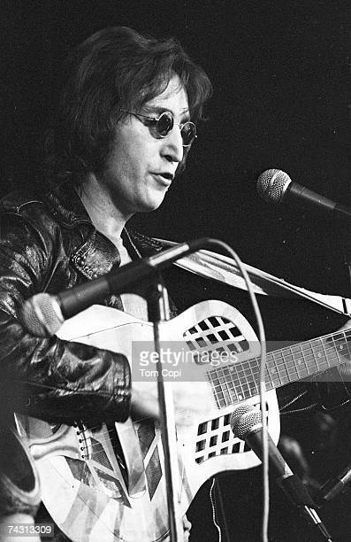 Musician John Lennon formerly of The Beatles performs onstage at the Chrysler Arena on December 10 1971 in Ann Arbor Michigan