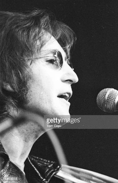 Musician John Lennon formerly of 'The Beatles' performs onstage at the Chrysler Arena on December 10 1971 in Ann Arbor Michigan