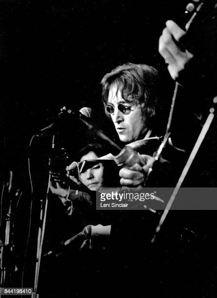 Musician John Lennon in performance with his wife Yoko Ono during the John Sinclair Freedom Rally at the Crisler Arena on December 10 1971