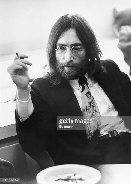 Musician John Lennon of the Beatles relaxing with a cigarette