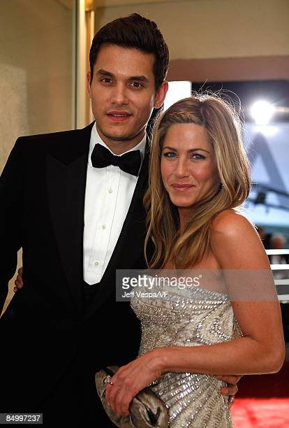 WEST HOLLYWOOD CA FEBRUARY 22 Musician John Mayer and actress Jennifer Aniston attend the 2009 Vanity Fair Oscar party hosted by Graydon Carter at...