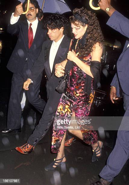 Musician John Oates of Hall and Oates and wife Aimee attend the 'Wedding of Mariah Carey and Tommy Mottola' on June 5 1993 at St Thomas Episcopal...