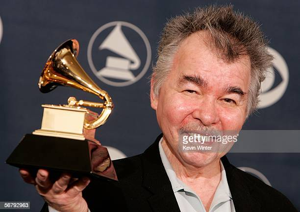 Musician John Prine poses with his award for Best Contemporary Folk Album in the press room at the 48th Annual Grammy Awards at the Staples Center on...
