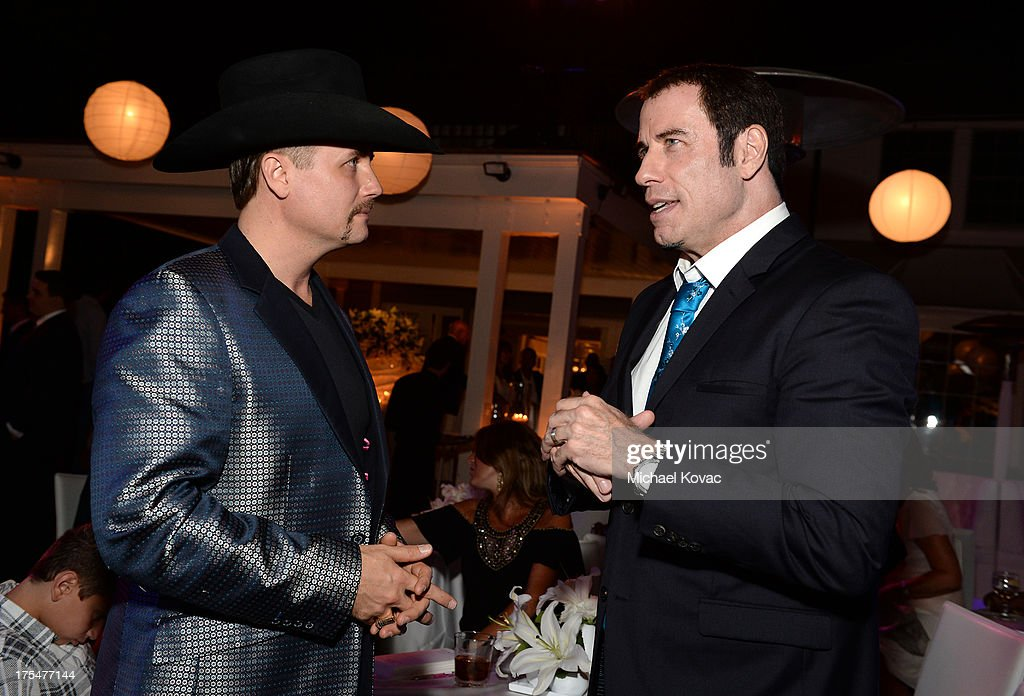Musician John Rich and actor John Travolta attend the 87th birthday celebration of Tony Bennett and fundraiser for Exploring the Arts, the charity organization founded by Mr. Bennett and wife Susan Benedetto, hosted by Ted Sarandos & Nicole Avant Sarandos among celebrity friends and family on August 3, 2013 in Beverly Hills, California.
